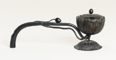 A long-handled bronze censer [