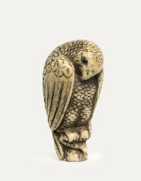 An ivory netsuke of a hawk