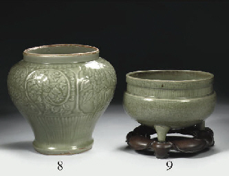 A celadon carved baluster jar