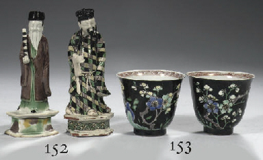 A pair of famille noire cups