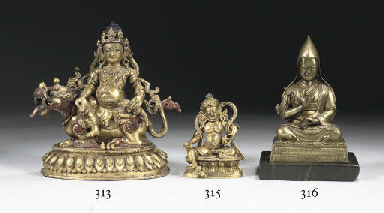 A Tibetan bronze figure of Jam