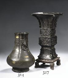 A bronze gilt-splashed vase