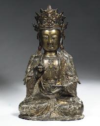 A bronze figure of Guanyin