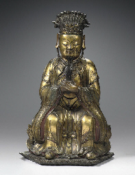 A Ming dynasty gilt-bronze fig