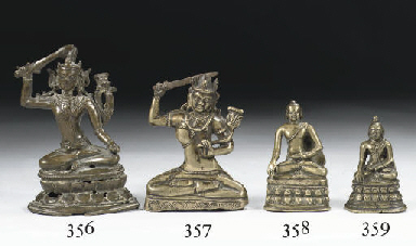 A Tibetan bronze figure of Aks