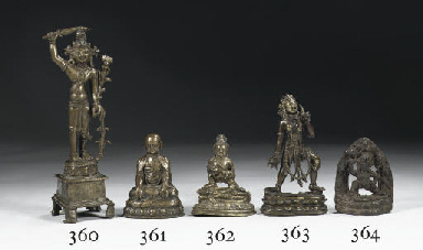 A Tibetan bronze figure of a l