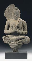 A Gandhara grey schist figure