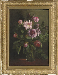 Pink roses in a glass vase, on
