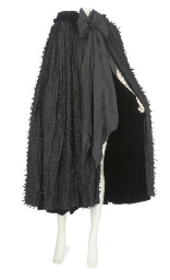 A BLACK SILK EVENING CAPE, 195