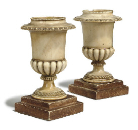 A PAIR OF IVORY CAMPAGNA URNS