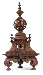 AN ITALIAN WALNUT ORNAMENTAL C