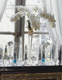 A FRENCH GLASS VASE OF TALL SL