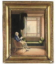 A gentleman seated, reading a
