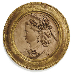 A TERRACOTTA ROUNDEL OF A LADY