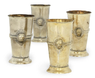 A SET OF FOUR GILT-METAL BEAKE