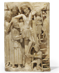 A CARVED RECTANGULAR ALABASTER