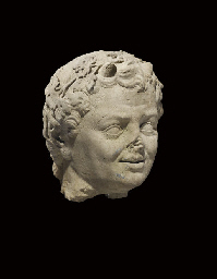 A CARVED STONE HEAD OF PAN