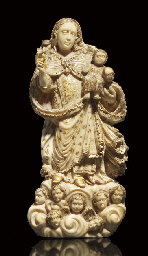 A PARCEL-GILT CARVED IVORY GRO