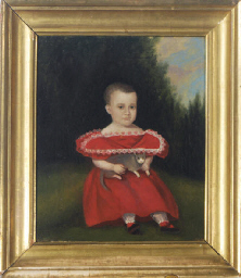 A seated girl in a red dress h