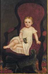 Child seated in a red chair wi