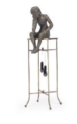 A PATINATED BRONZE FIGURE,