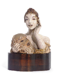 A GLAZED TERACOTTA BUST,