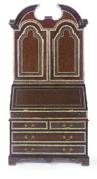 A LEATHER BOUND BUREAU BOOKCAS
