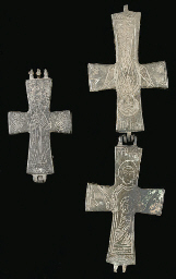 TWO RELIQUARY PENDANT CROSSES