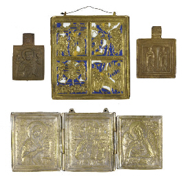 A GROUP OF FOUR BRASS TRAVELLI