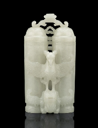 A FINELY CARVED WHITE JADE 'CH
