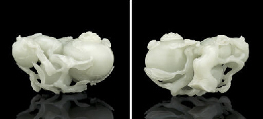 A FINELY CARVED WHITE JADE WAT
