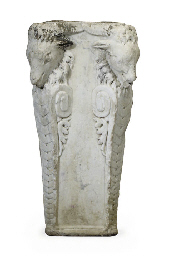A CARVED MARBLE PEDESTAL