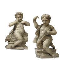 A PAIR OF CARVED MARBLE SEATED