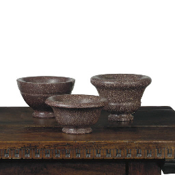 THREE CARVED PORPHYRY MORTARS