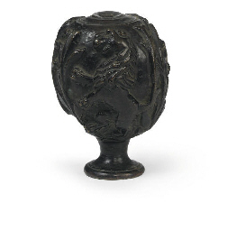 A SPHERICAL BRONZE FINIAL