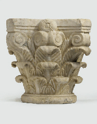 A CARVED MARBLE CORINTHIAN CAP