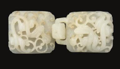 A mottled white jade belt buck