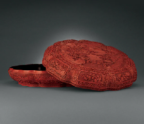 A LARGE FINELY CARVED CINNABAR
