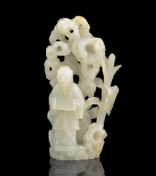 A WHITE JADE CARVING OF A SCHO
