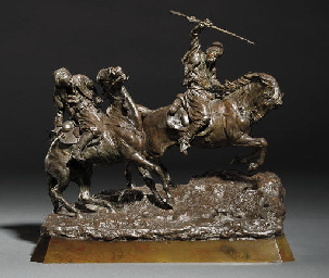 A bronze group of two horsemen
