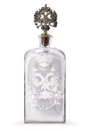 An engraved glass decanter