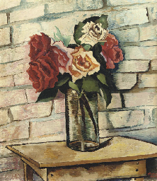 A still life with roses in a g