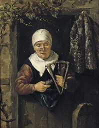 An old woman standing in a doo