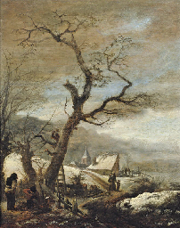 A winter landscape with woodcu