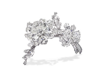 A DIAMOND FLOWER BROOCH, BY BU