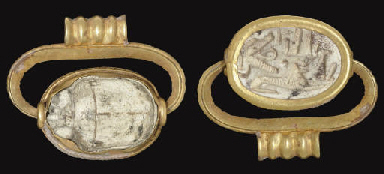 AN EGYPTIAN GOLD AND STEATITE