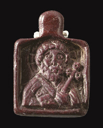 A BYZANTINE RED STEATITE PENDA