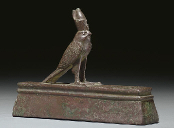 AN EGYPTIAN BRONZE HORUS ON A