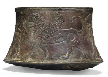 AN ASSYRIAN BRONZE BASIN