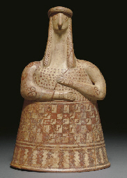 A GREEK TERRACOTTA FEMALE FIGU